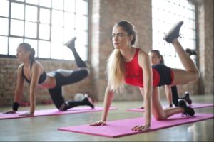 woman taking yoga classes