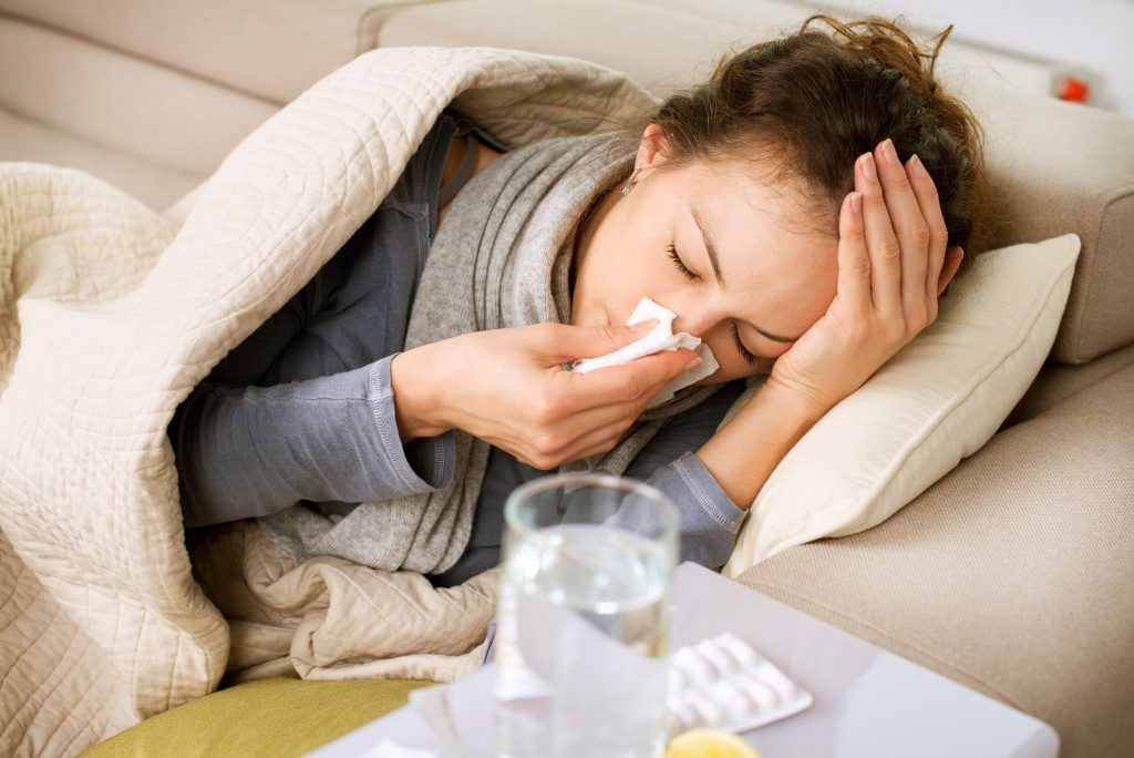 Woman experiencing fever and colds
