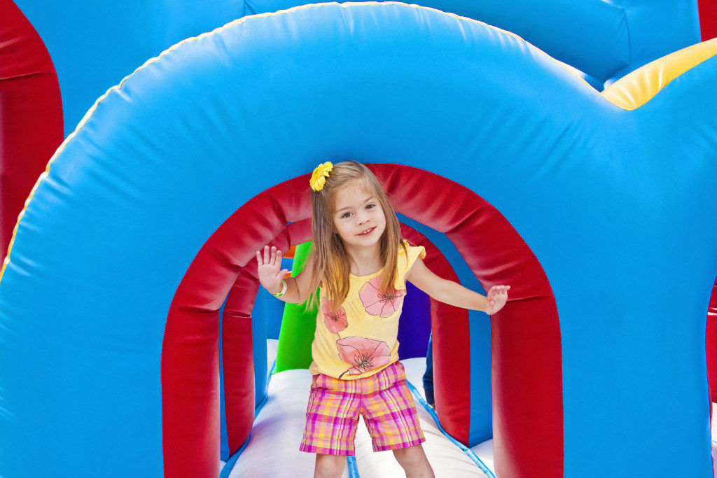 kid playing in the inflatable playground